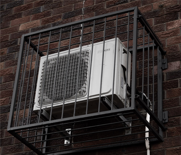 air conditioner on side of building