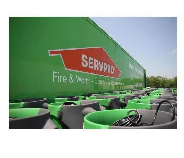 SERVPRO logo with equipment
